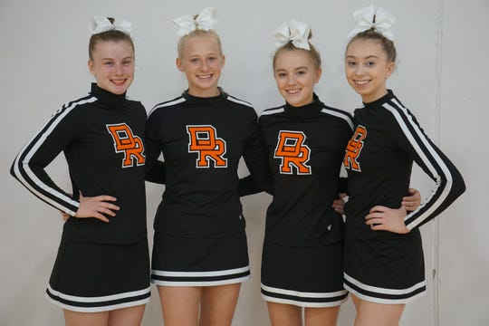 Seniors Cydney Lee, Hannah Heiberger, Katelyn North, and Kaylei Oberg were recognized at the September 10 Dell Rapids Competitive Cheer Competition. Combined, these four have participated in competitive cheer for 23 years.