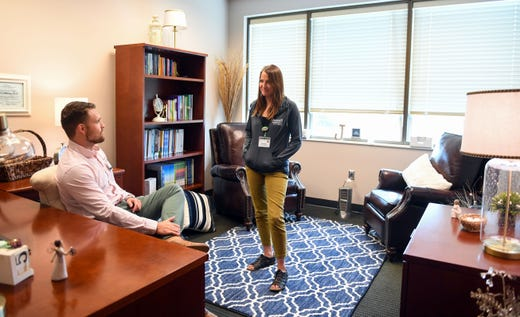 Triage outpatient therapist Derek Granum speaks with Behavioral health technician Kristin Hayen between seeing patients at the Avera Behavioral Health Center on Monday, September 16, in Sioux Falls.