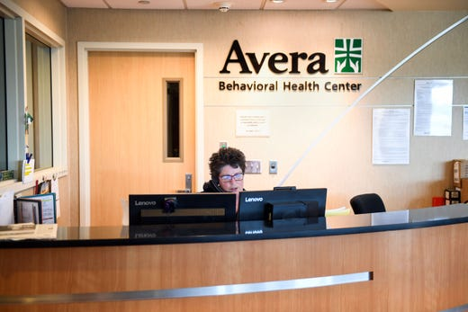 Carla Bamsey works the registration desk for patient assessments at the Avera Behavioral Health Center on Monday, September 16, in Sioux Falls.
