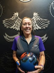 Margie O'Neill poses after rolling her first career 600 series, a 603 at Sunset Lanes.