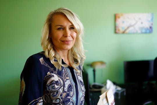 """Katarina Maloney is pictured in her company's offices in Carlsbad, Calif., on Aug. 27, 2019. Maloney is the CEO of Mathco Health Corporation, which sells products made with the cannabis extract CBD. Documents filed in a California court by a former employee, as well as interviews with two other former employees, link Maloney's company to Yolo! brand CBD vape oil, a product that authorities blamed for sickening people in 2017 and 2018 because it was spiked with dangerous synthetic marijuana. Maloney said Mathco does not """"engage in the manufacture, distribution or sale of any illegal products"""" and said the company can't control what happens to products once they are shipped. (AP Photo/Gregory Bull)"""