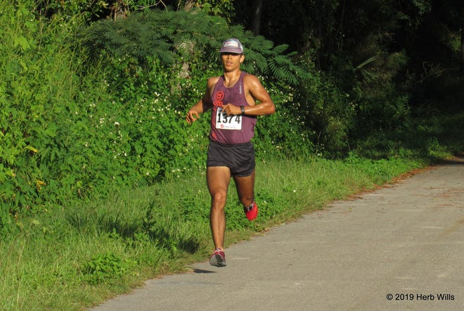 Paul Allen went on to win the Sickle Cell 5K by well over 300 meters in 16:02.