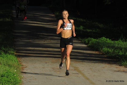 Ann Centner was the first woman in the race, placing fifth overall in 18:09. She is Florida State student, pursuing a doctoral degree in nutrition science.