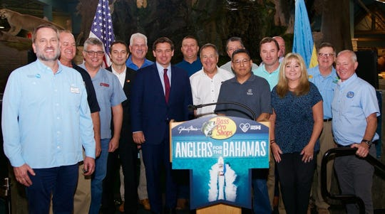 Bass Pro Shops founder Johnny Morris (center in white shirt), and Florida Gov. Ron DeSantis (left of Morris), announced  the creation of the Anglers for the Bahamas relief campaign.