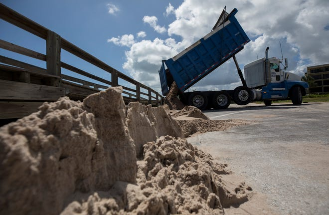 Indian River County begins Nov. 1 the first phase to replenish Vero's beaches damaged by hurricanes Matthew and Irma. Work begins a Tracking Station Park and will move south to access points at Jaycee/Conn Beach and Humiston Beach parks. In this photo, taken Monday, Sept. 16, 2019, the Vero Beach streets department made emergency sand repairs at the Conn Beach boardwalk along Ocean Drive south of Jaycee Park after Hurricane Dorian caused further erosion.