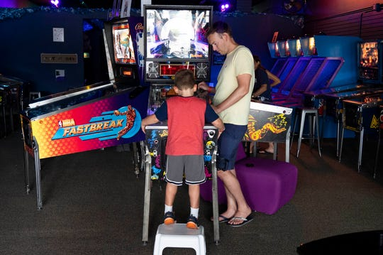 Families enjoy the entertainment at Play Money Pinball on Sunday, Sept. 15, 2019, in Stuart. The family friendly arcade, which opened last February, is the only retro arcade of its kind on the Treasure Coast with more than 30 pinball machines, old-school arcade games, air hockey, table shuffleboard and video game consoles. It costs $15 for unlimited play and $10 if you come in before 4 p.m. on weekdays. Visitors, including parents, grandparents and chaperones do not have to pay if they are not playing the games.