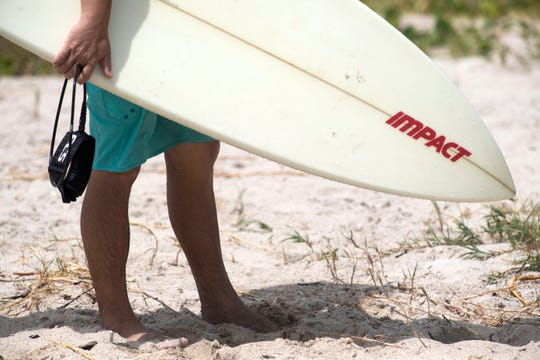 Dozens of surfers took the sea to ride waves churned up by Hurricane Humberto on Monday, Sept. 16, 2019, at Fort Pierce Inlet State Park. The hurricane, located a couple hundred miles offshore, produced big swells along the Southeast coast of the United States and attracted surfers from around Florida to the state park.
