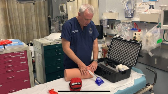 Dr. Stephen Flaherty, medical director of trauma at Del Sol Medical Center, demonstrates how to pack a wound as part of the Stop the Bleed program.