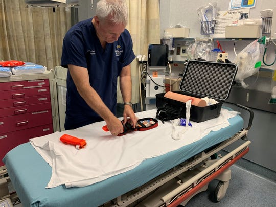 Dr. Stephen Flaherty, medical director of trauma at the Del Sol Medical Center, shows the medical equipment that is included in the Stop the Bleed kits.