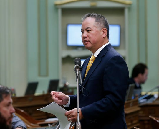 In this Tuesday, Sept. 3, 2019 photo, Assemblyman Phil Ting, D-San Francisco speaks during the Assembly session in Sacramento, Calif. The state Senate approved Ting's measure that allows employers, co-workers and teachers to ask a judge to take away guns from people who are a danger to themselves or others, Wednesday, Sept. 4, 2019. (AP Photo/Rich Pedroncelli)