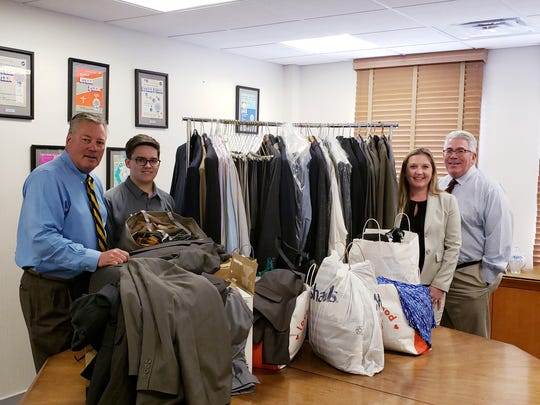 (From left) Kenneth J. Calemmo, chief operating officer, Cooper Levenson Attorneys at Law; William Reynolds, St. Augustine College Preparatory School student; and Amy E. Rudley and Randolph C. Lafferty, partners, Cooper Levenson, are shown with business suits collected as part of Reynolds' Caritas Project.