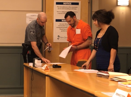 Millville resident Michael N. Tedesco (center) was arraigned Monday, Sept. 26 in Cumberland County Superior Court. Tedesco is charged with first degree murder in the stabbing of his father. He stands here with state Public Defender Dinaz Akhtar.