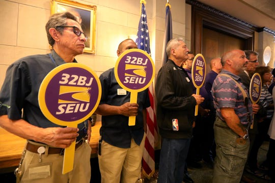 embers of union 32 BJ SEIU attend a news conference outside the Westchester County Board of Legislators chambers in White Plains Sept. 16, 2019. Members of the county legislature will be seeking to strengthen a law protecting displaced workers when building ownership or service contracts change hands.