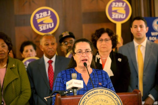 Lenore Friedlaender, assistant to the president of union 32 BJ SEIU, speaks during a news conference outside the Westchester County Board of Legislators chambers in White Plains Sept. 16, 2019. Behind her is Benjamin Boykin, chairman of the Westchester County Board of Legislators, and county legislators Catherine Borgia (D), David Tubiolo (R).The county legislature will be seeking to strengthen a law protecting displaced workers when building ownership or service contracts change hands. This law will effect workers such as cleaning crews who work in office buildings.