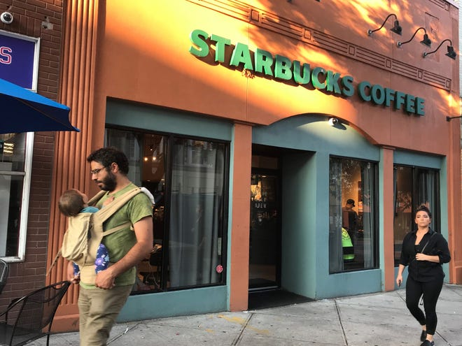 """The Starbucks on Main Street in Nyack. The bathroom that has a swastika carved on a wall inside is locked and is """"under repair."""""""