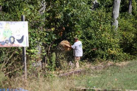 The site in Smyrna's Little Lass softball fields, where the remains of a child were found on Friday, sits quiet on Monday, Sept. 16, with a sole landscaper tidying the scene.