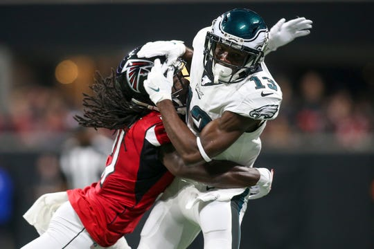 Falcons cornerback Desmond Trufant (21) breaks up a pass intended for Philadelphia Eagles wide receiver Nelson Agholor (13) in the first quarter at Mercedes-Benz Stadium in Atlanta on Sunday.
