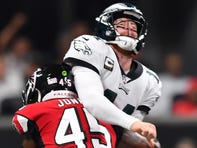 Battered Eagles' late push falls just short in loss to Falcons