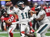 Wentz overcomes injuries, shows toughness in almost leading Eagles back