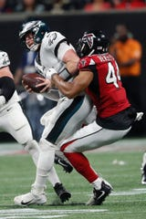 Atlanta Falcons linebacker Vic Beasley (44) sacks Philadelphia Eagles quarterback Carson Wentz (11) during the second half of an NFL football game, Sunday, Sept. 15, 2019, in Atlanta. The Atlanta Falcons won 24-20.