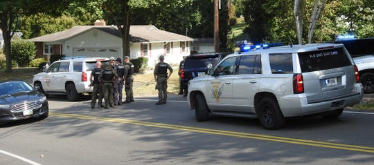 Members of the Ohio State Highway Patrol, Coshocton County Sheriff's Office and other agencies staged Monday afternoon on Pleasant Valley Drive between Pareson Avenue and Evergreen Park Drive while a suspect from a semi chase was pursued on foot.