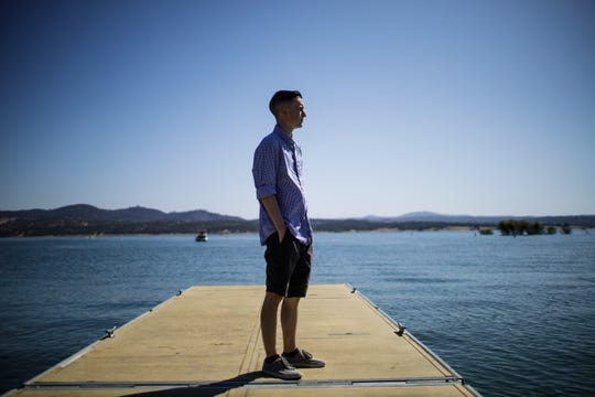 Ricky D'Ambrosio, 21, poses for a portrait at Folsom Lake in Granite Bay, Calif. near his home. D'Ambrosio used to waterski and wakeboard in the lake but has trouble walking to the end of his driveway since his release September 10th from the hospital  where he was in a medically induced coma due to acute respiratory failure from vaping nicotine and THC.