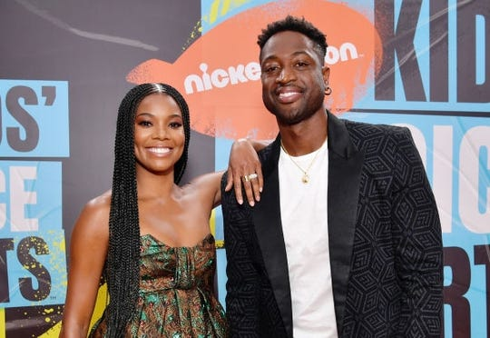 Dwyane Wade, Gabrielle Union launch T-shirt line supporting LGBTQ kids after embracing son