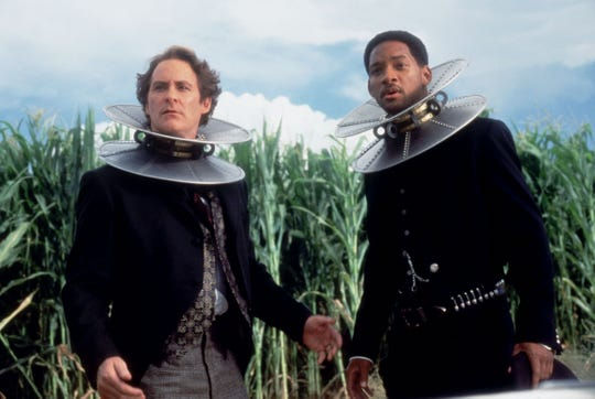 "Artemus Gordon (Kevin Kline, left) and James West (Will Smith) are forced to wear magnetic collars in the Western comedy adventure ""Wild Wild West."""