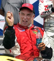 Mike Stefanik celebrates a win on the NASCAR Whelen Modified Tour in 2012.