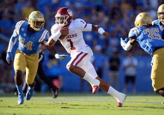 Oklahoma quarterback Jalen Hurts runs the ball during the first half against UCLA.