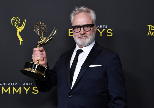 "Bradley Whitford poses in the press room with the award for outstanding guest actor in a drama series for ""The Handmaid's Tale"" on Night 2 of the Creative Arts Emmy Awards on Sunday."