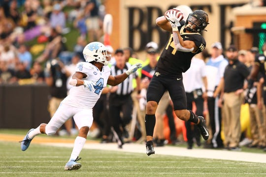 Wake Forest wide receiver Sage Surratt  catches a pass during the first quarter against North Carolina.