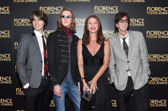 """Ric Ocasek and Paulina Porizkova have two sons, Jonathan, left, and Oliver. Here, the family attends the New York premiere of """"Florence Foster Jenkins"""" on Aug. 9, 2016."""