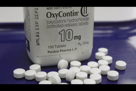 The company that made billions selling OxyContin has filed for bankruptcy protection. This comes after it reached a tentative settlement with many governments.