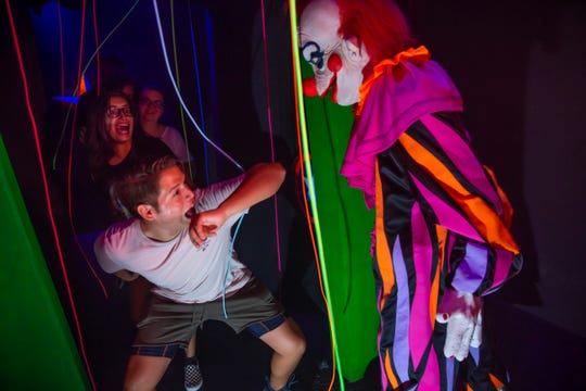 """You'd be wise to face your fear of clowns before hitting up the """"Killer Klowns From Outer Space"""" house at Universal Studios."""