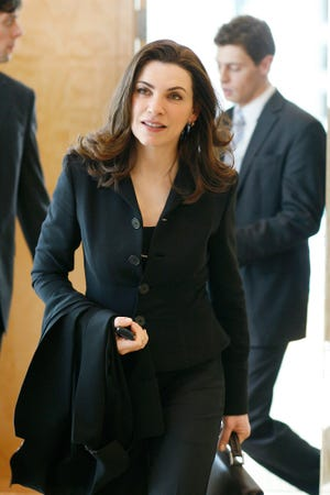 """Julianna Margulies, seen in a picture from her critically acclaimed drama """"The Good Wife,"""" almost didn't become a regular on """"ER,"""" because her character originally died in the series pilot."""