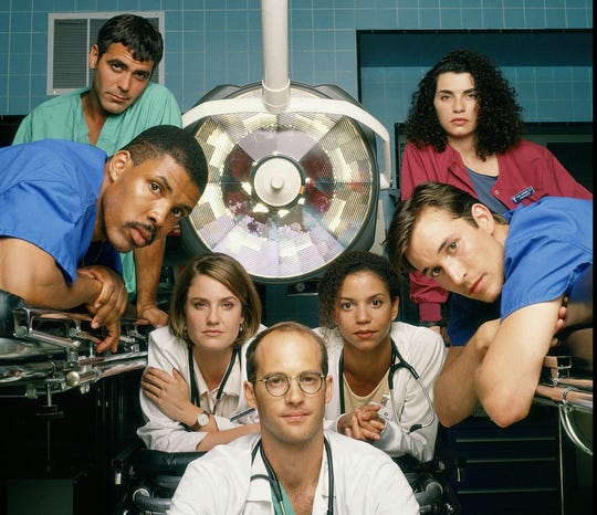 """During its 15-season run, NBC's """"ER"""" featured a long list of actors who became big-name stars, including George Clooney, left, Eriq La Salle, Sherry Stringfield, Anthony Edwards, Gloria Reuben, Noah Wyle and Julianna Margulies."""