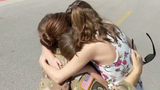 """After being overseas for 9 months, this mom just couldn't wait to hug her girls. """"These kids are my heart, I have my heart back."""""""