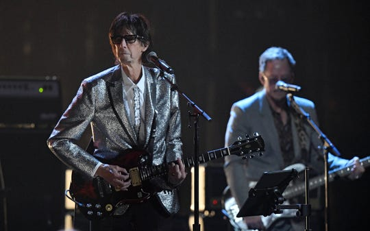 Ric Ocasek, left, of The Cars, performs during the Rock and Roll Hall of Fame induction ceremony on April 14, 2018, in Cleveland.