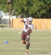 Brownwood senior quarterback Drew Huff throws a pass during practice Tuesday, Sept. 10, 2019, at Brownwood High School.