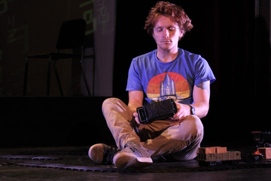 """Christopher Boone (Wade Byington) plays with his trains before venturing out by himself on one in this rehearsal scene from the Paramount Theatre's production of """"The Curious Incident of the Dog in the Night-Time."""" Sept. 16 2019"""