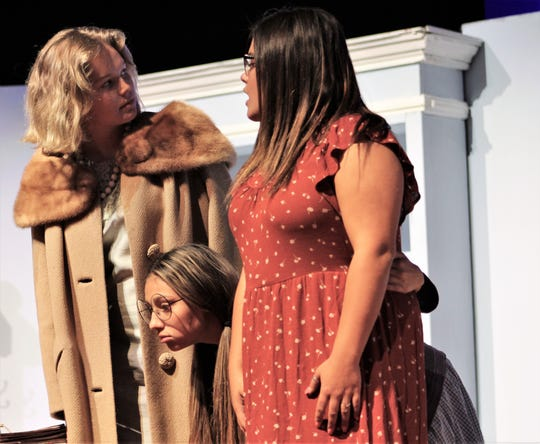 "Fairy Mae (Emilee Garcia) pokes her head between Mrs. Savage (Avery French) and another resident of The Cloisters (Cookie Harrell) in this rehearsal scene of Wylie High School's ""The Curious Savage."""