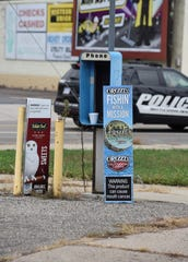 An empty pay phone box near the corner of South Jay and Main Street in downtown Battle Creek.