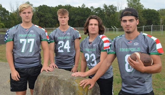 Pennfield captains Jack Boyd, Cody Hultink, Seth Clothier and Ryne Petersen show off the uniforms Pennfield will be wearing on Military Appreciation Night.