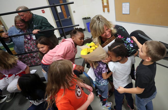 Students move in to hug second-grade teacher Kim Witte after Witte was named the VFW K-5 Washington State Educator of the Year during an assembly at Esquire Hills Elementary School in Central Kitsap on Tuesday.