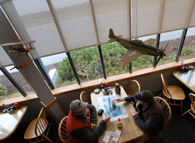 Diners enjoy the view out the windows after their meal at the Airport Diner in 2014. The diner announced it will close at the end of 2019.