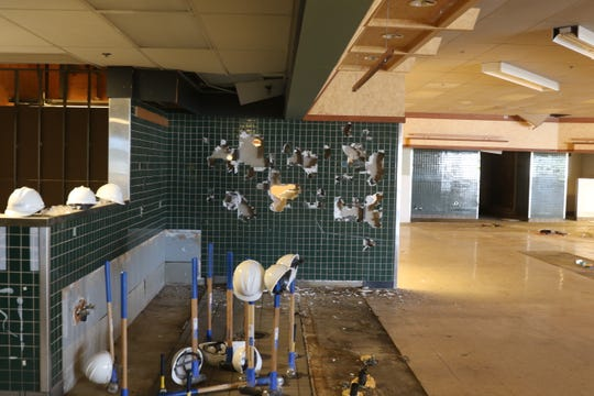 The aftermath of a tile wall inside the former QFC property along Kitsap Way. CHI Franciscan broke ground on its new outpatient clinic in the 26,000-square-foot building on Monday. The clinic is expected to open in May 2020.