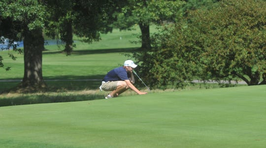 Galion's Bronson Dalenberg lines up his putt on the 6th green at Westbrook Country Club.