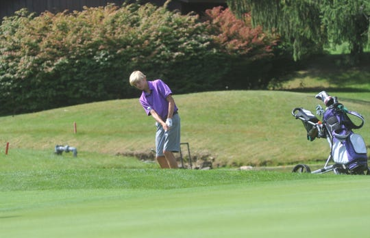 Lexington's Trevin Smith chips onto the 3rd green at Westbrook Country Club.