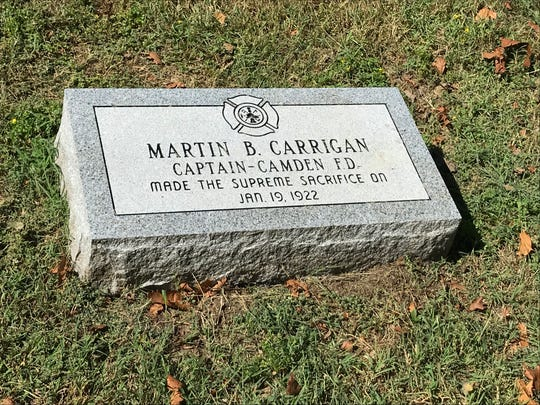 A new headstone marks the final resting place of Capt. Martin Carrigan, a Camden firefighter killed in the line of duty in 1922.